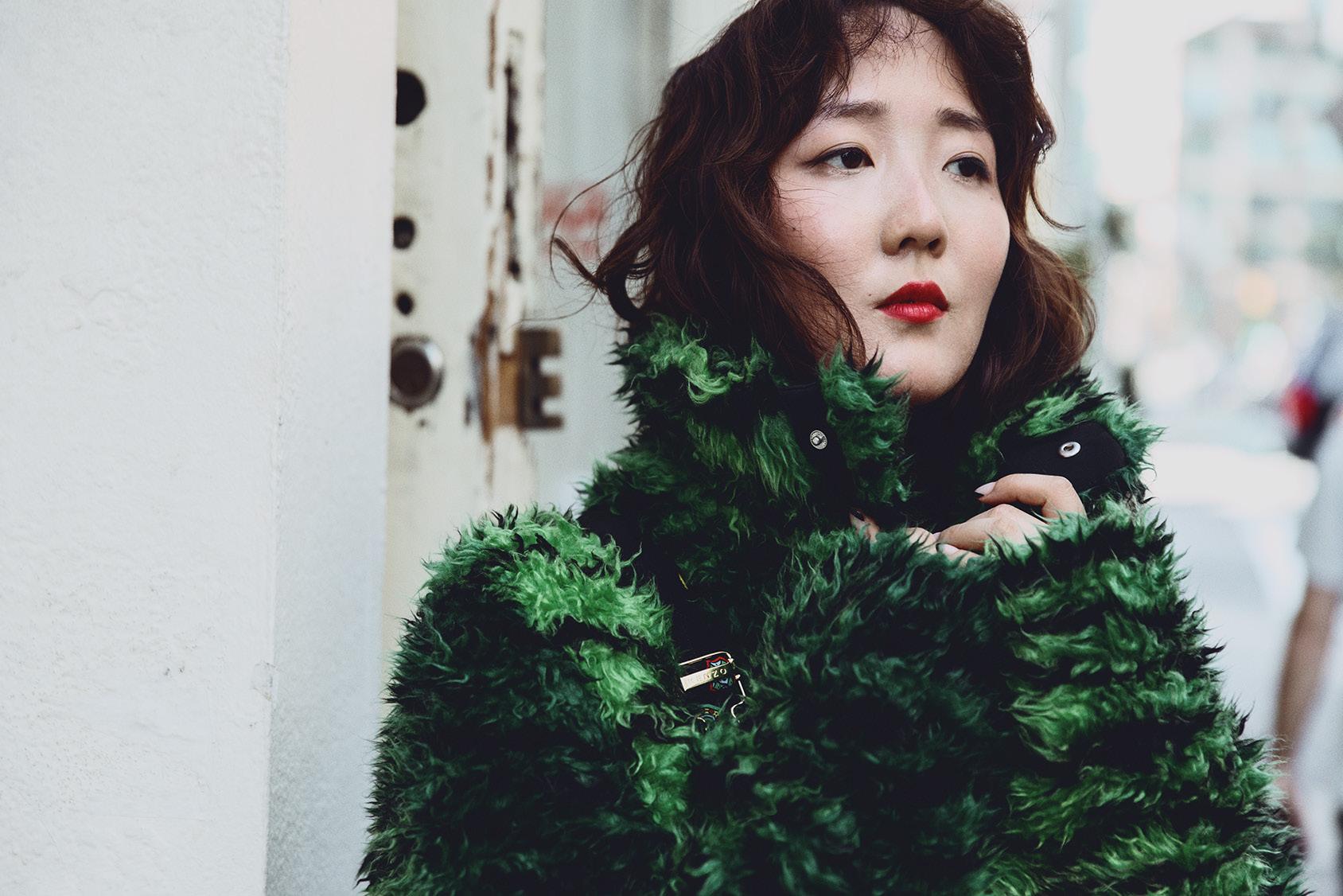 Shini Park wearing H&M x Kenzo jacket