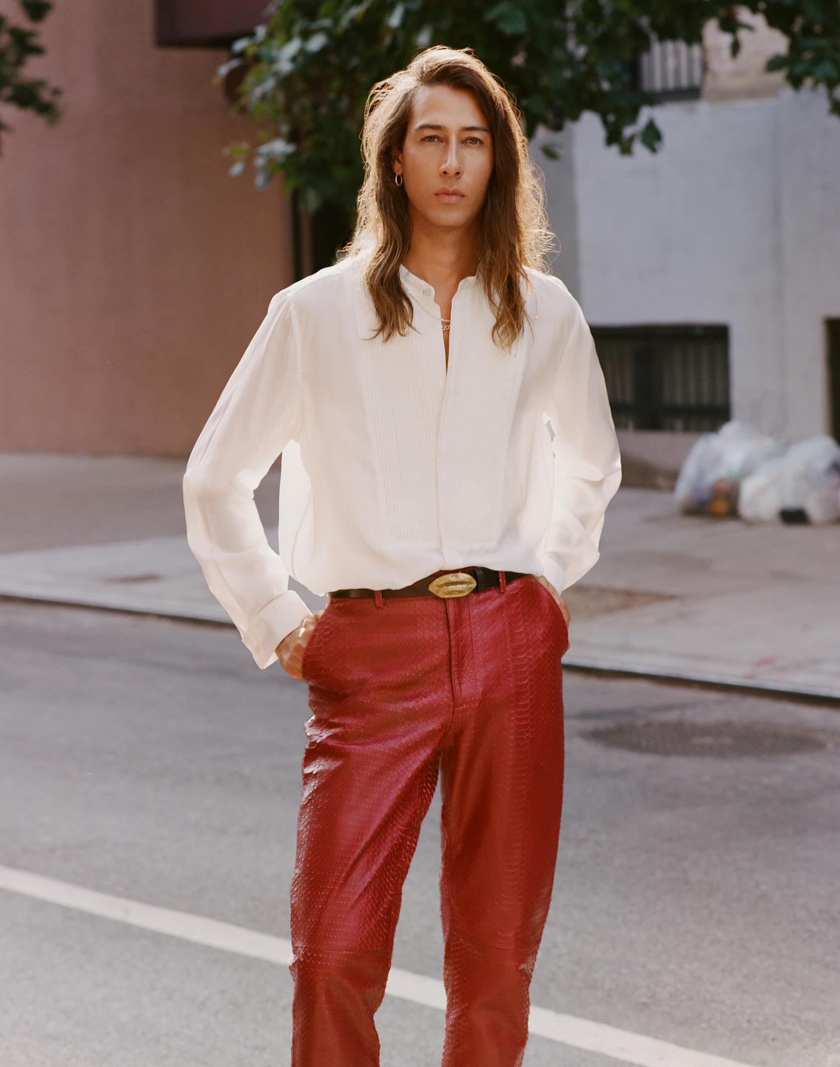 Kindness wearing GIAMBATTISTA VALLI x H&M white silk shirt and red leather pants.
